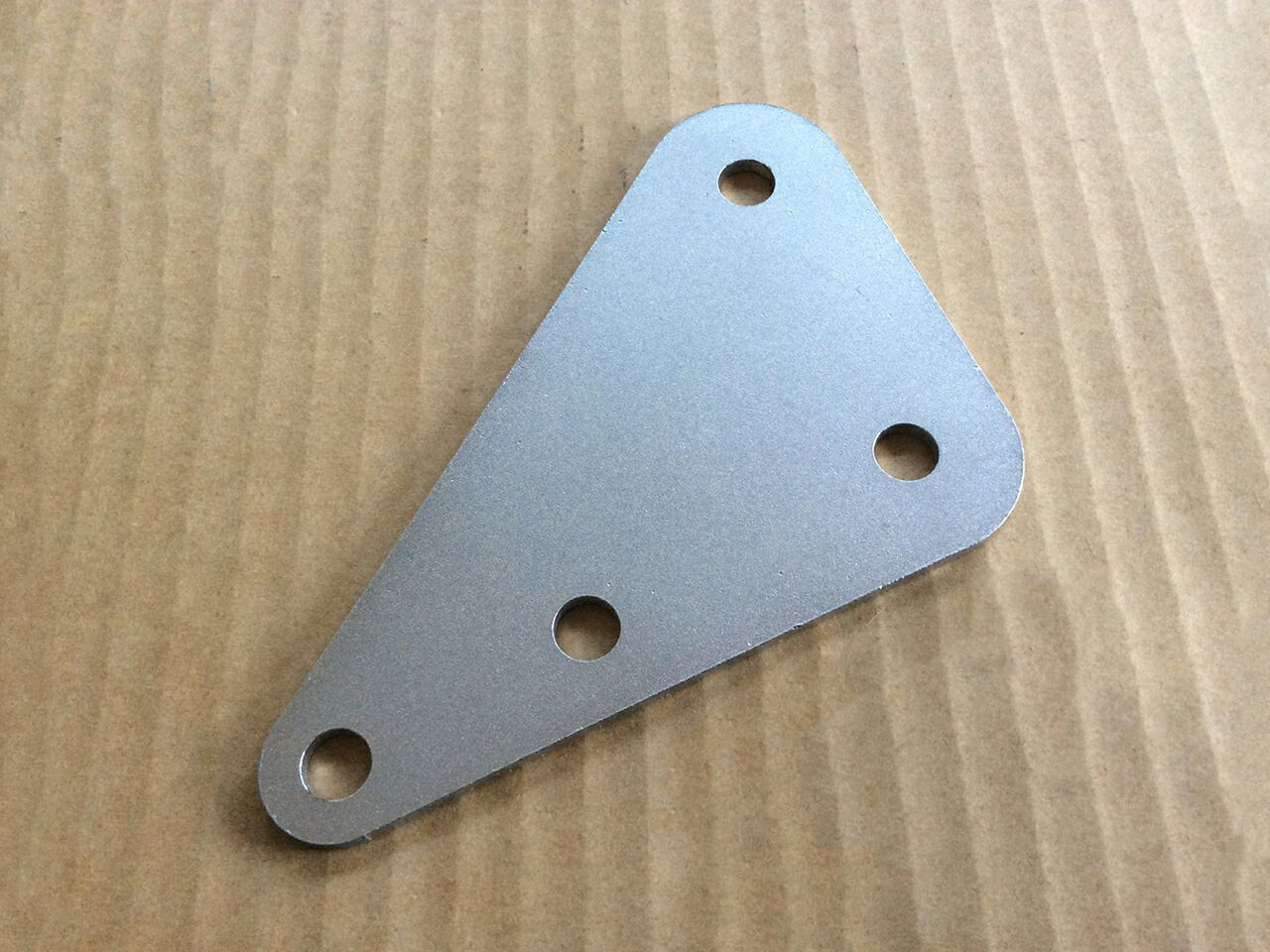 064150 Norton Commando Mk3 muffler mounting bracket - Classic Bike Spares